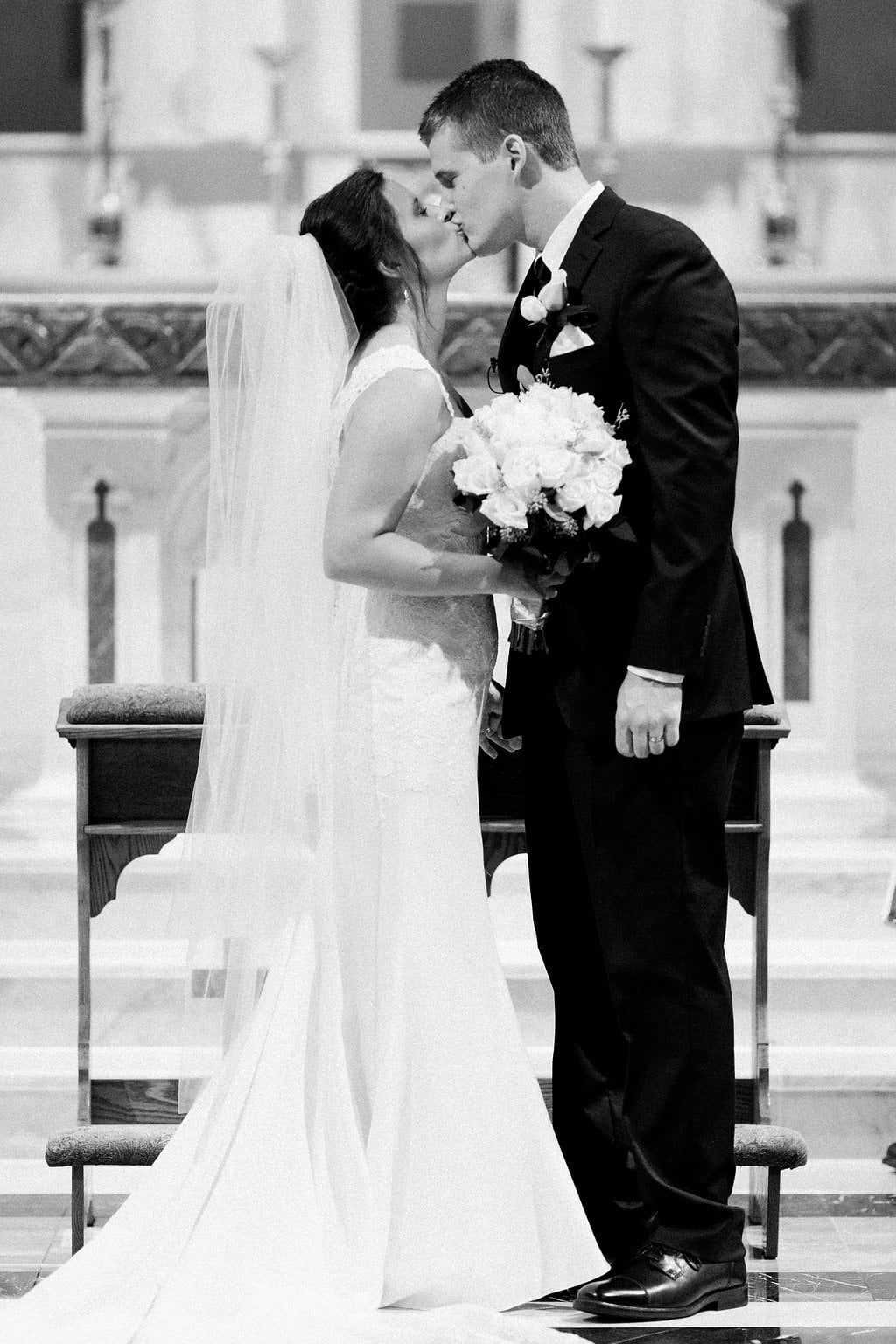Black and white photo of first kiss as husband and wife