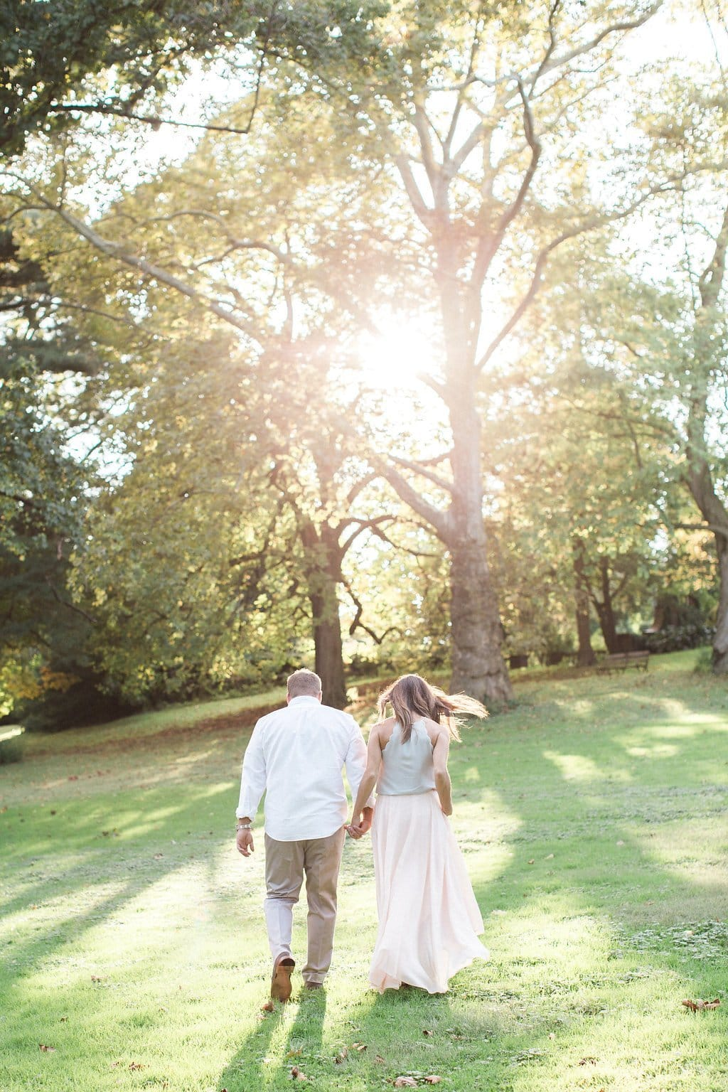 Couple walking together away from the camera holding hands