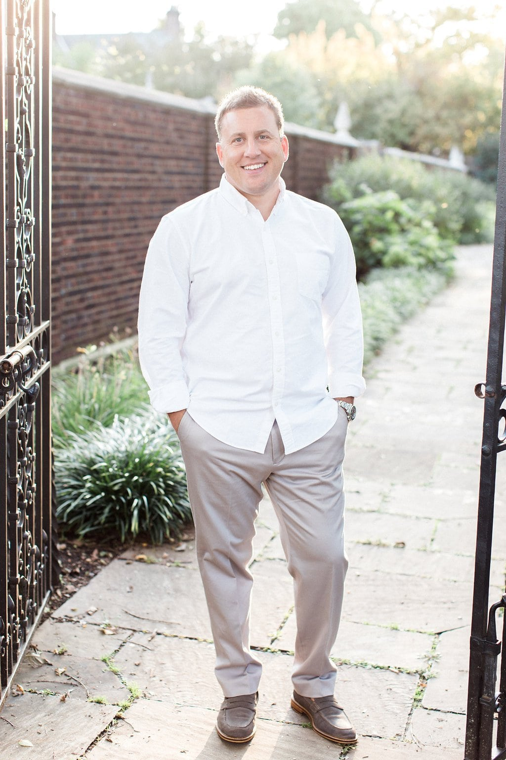 Portrait of groom wearing a white button down and khaki pants