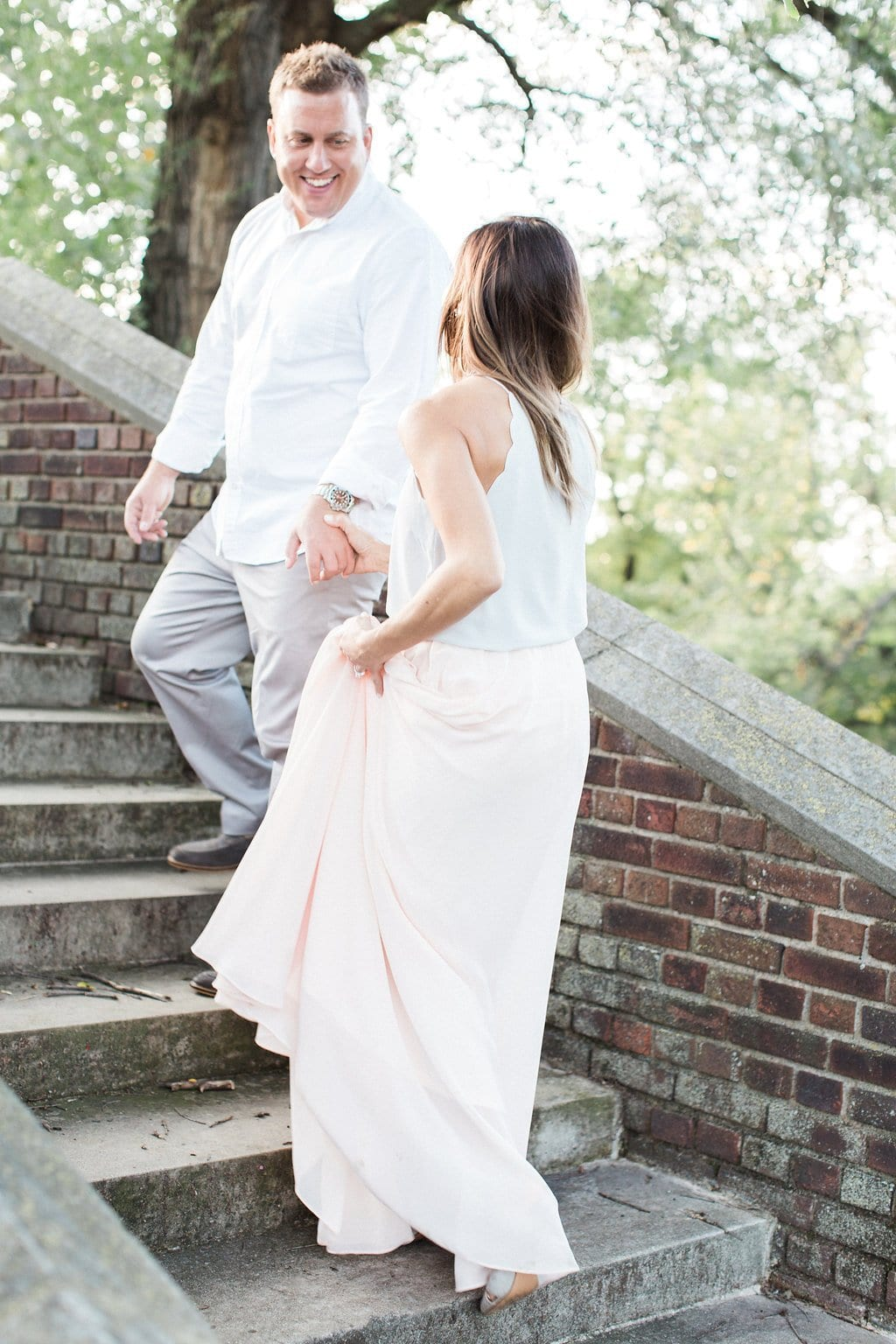 Couple walking up stone stairs at the walled garden