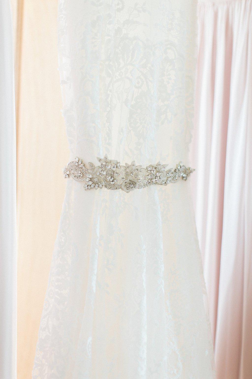 Close up of wedding dress belt detail