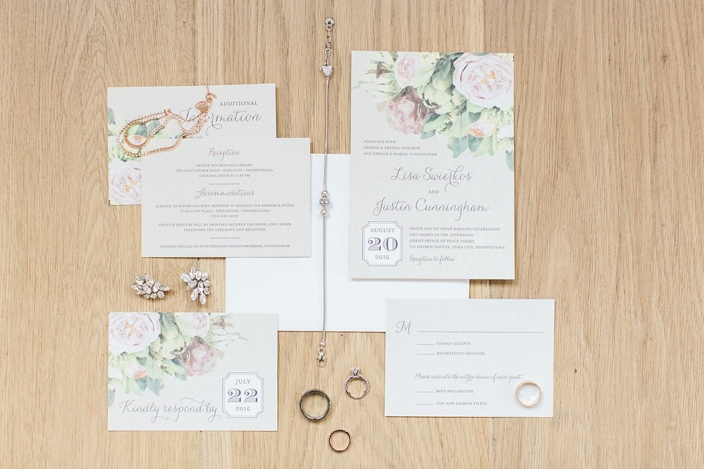 Wedding invitation lay flat with jewelry