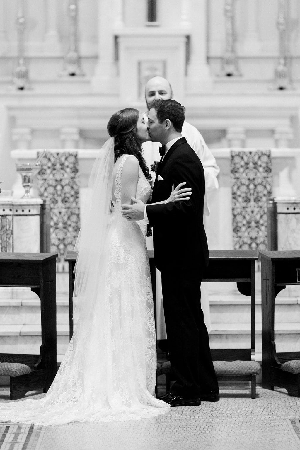 Bride and groom first kiss at the church altar