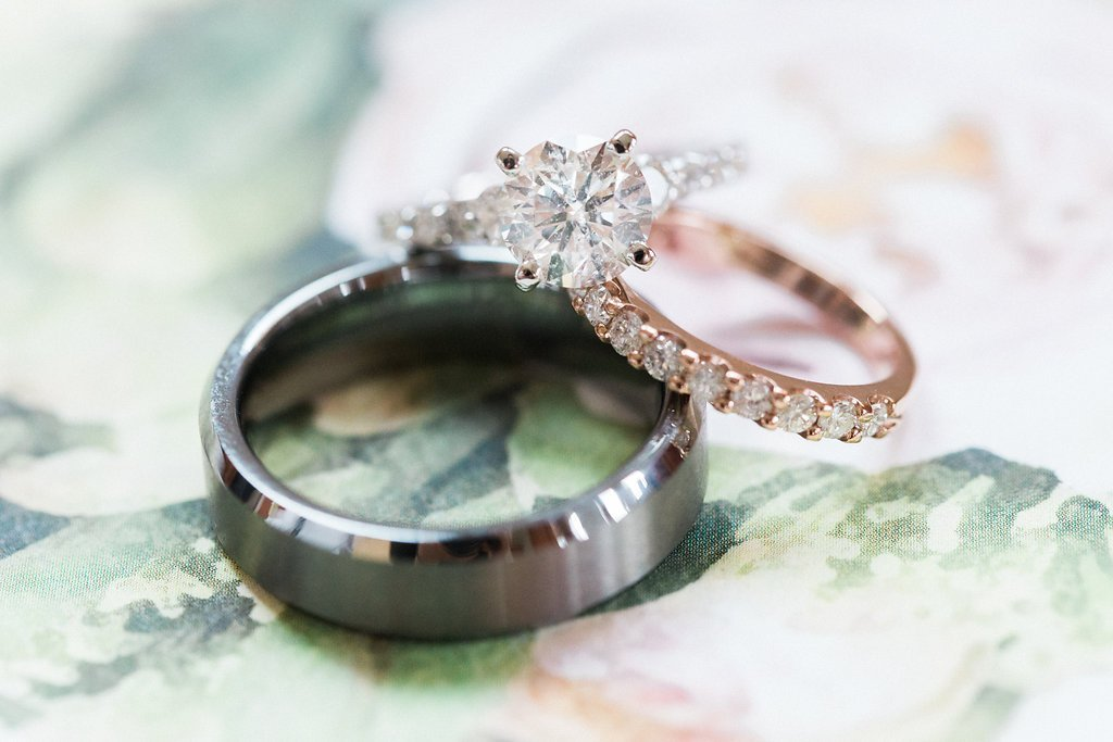 diamond engagement ring and rose gold wedding band