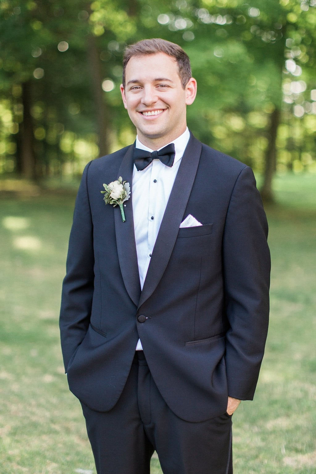 portrait of groom wearing a tux on his wedding day