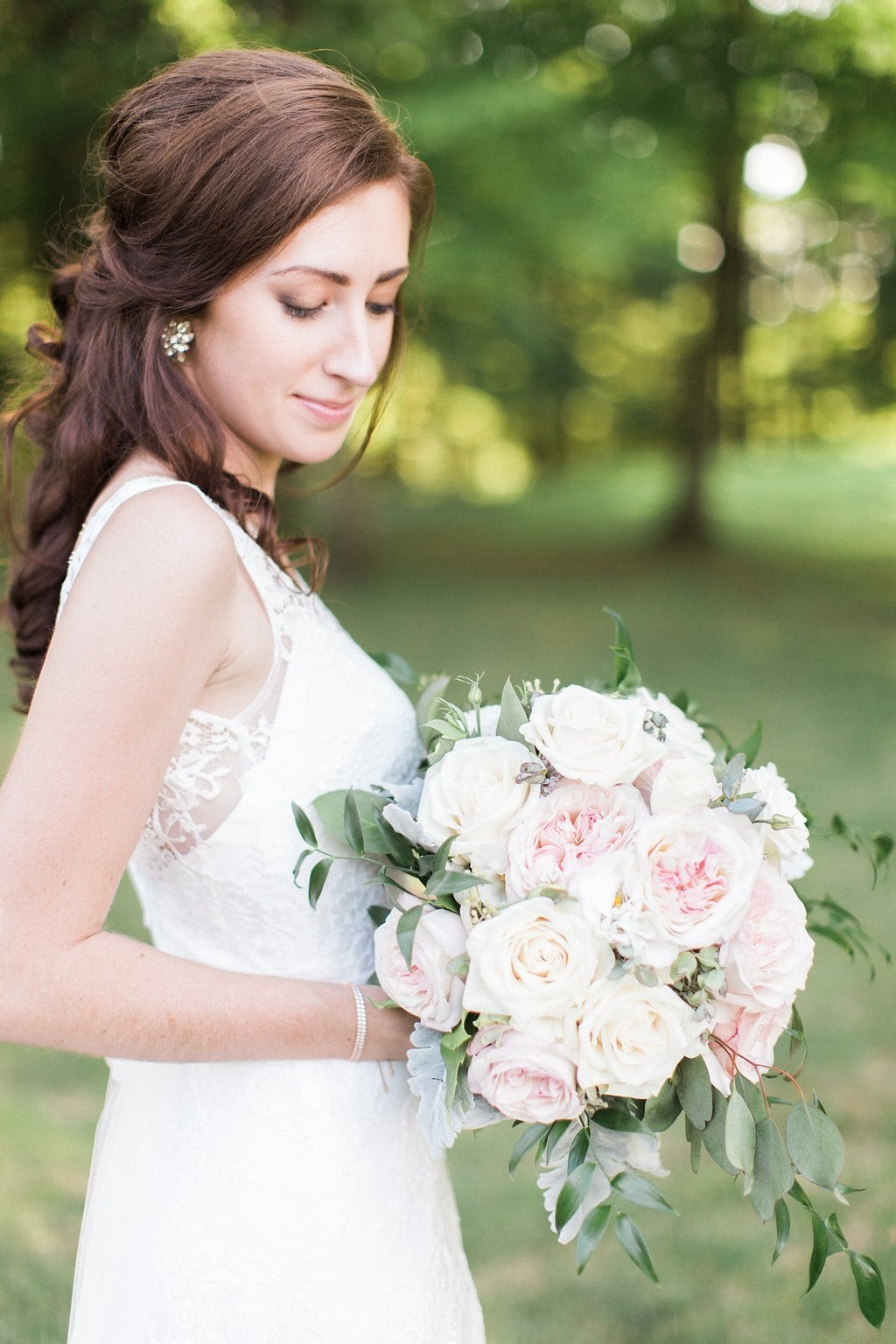 Portrait of brie holding bouquet and looking down at the flowers