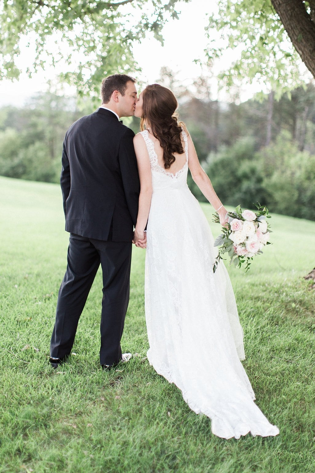 Bride and groom portraits of them kissing