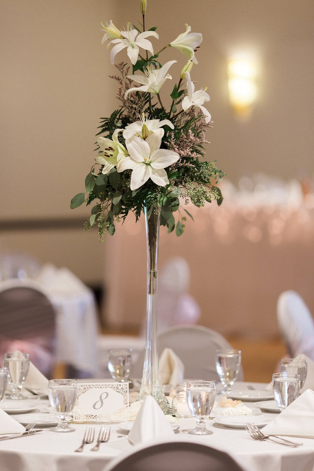 Tall centerpiece with lilies as wedding decor