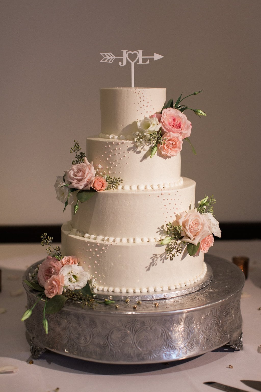 Wedding cake decorated with pink flowers