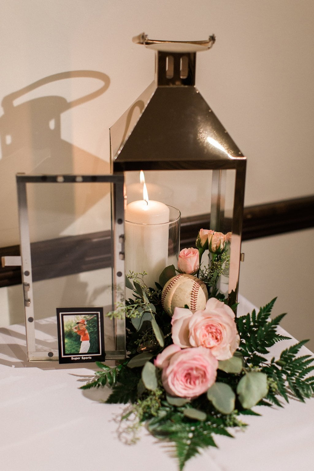 candle with flowers at gift card table