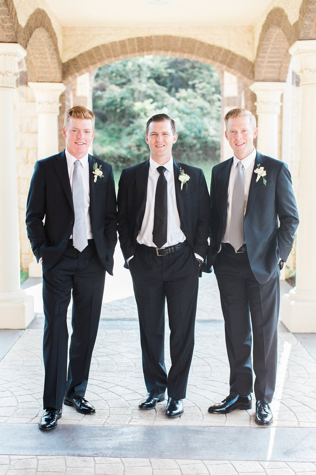 Groom with his Groomsmen outside the church before the wedding ceremony