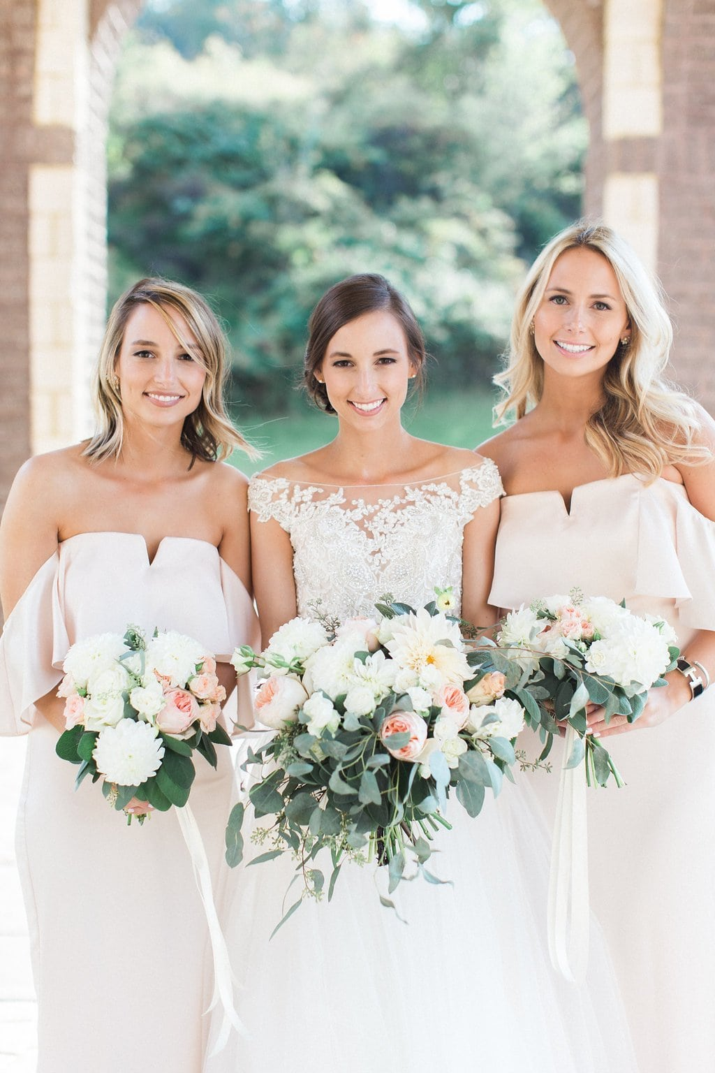 Bride with her bridesmaids outside of the church