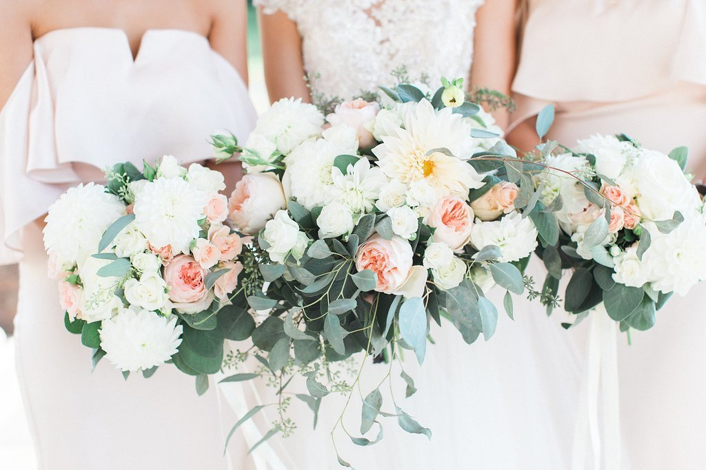 Photograph of bride and bridesmaids bouquets blush pink green and white