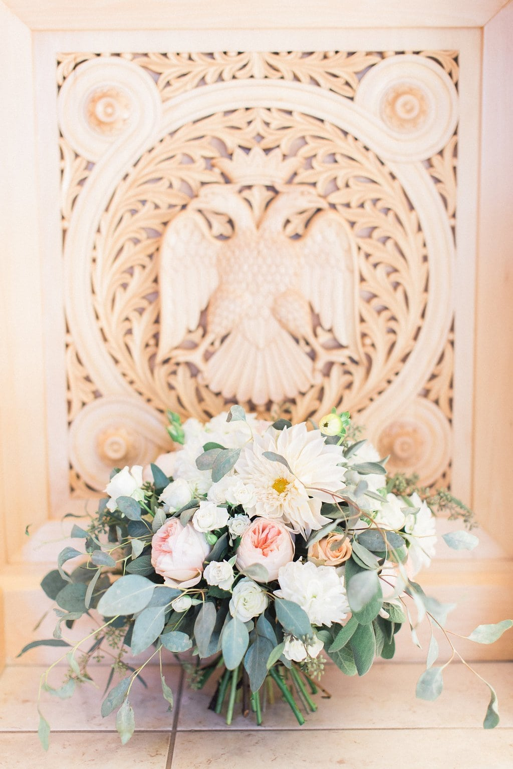 Bride's blush pink and white bouquet photographed inside the church