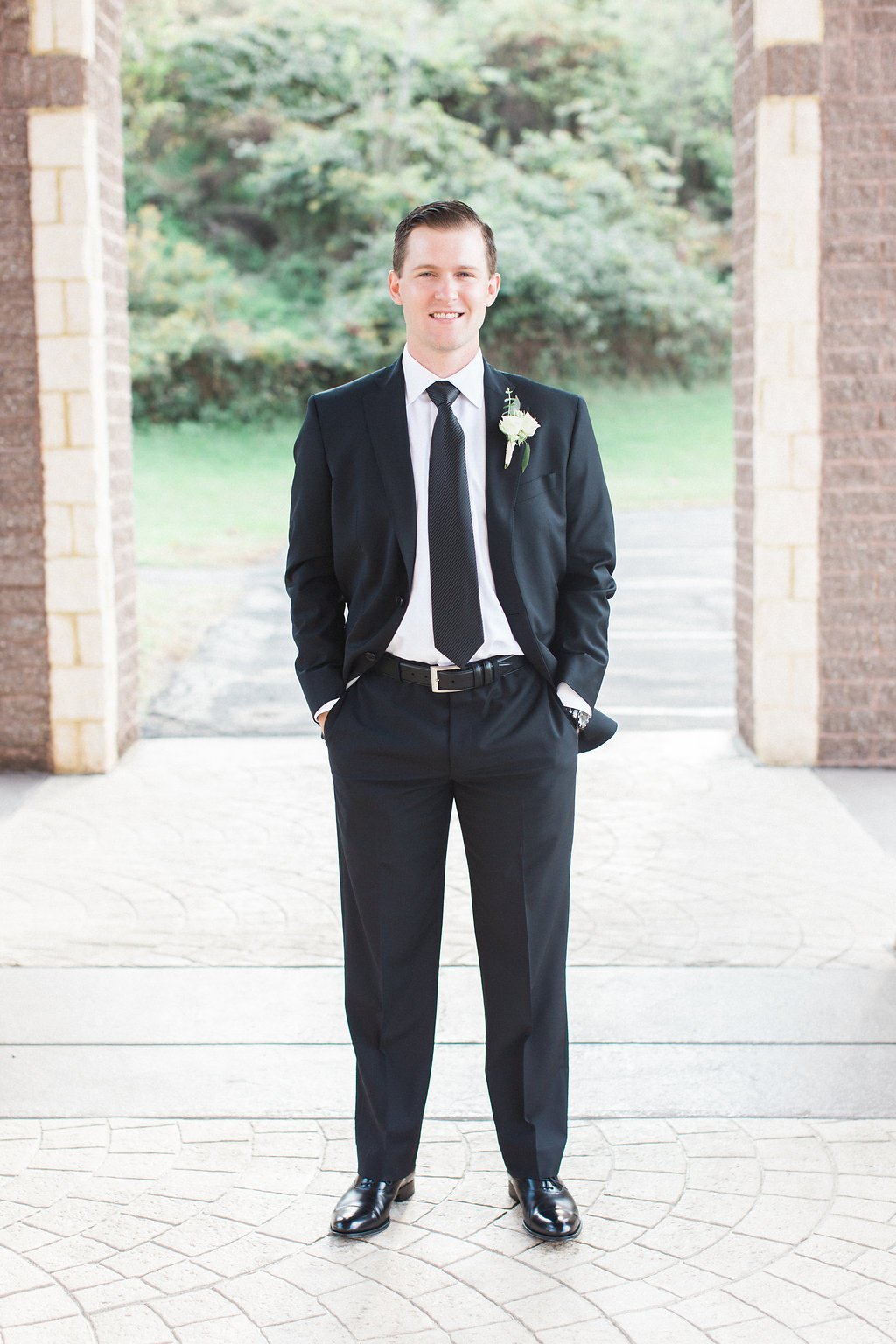 Groom portraits outside All Saints Greek Orthodox Church