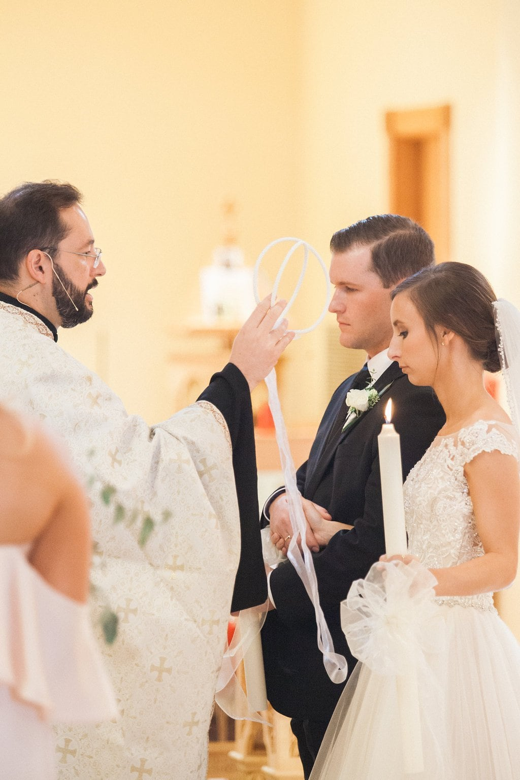 Greek Priest blessing the bride and groom during their wedding ceremony