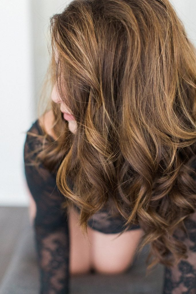 Photograph of bride posing to show her hair style during boudoir session: Pittsburgh Boudoir Photography