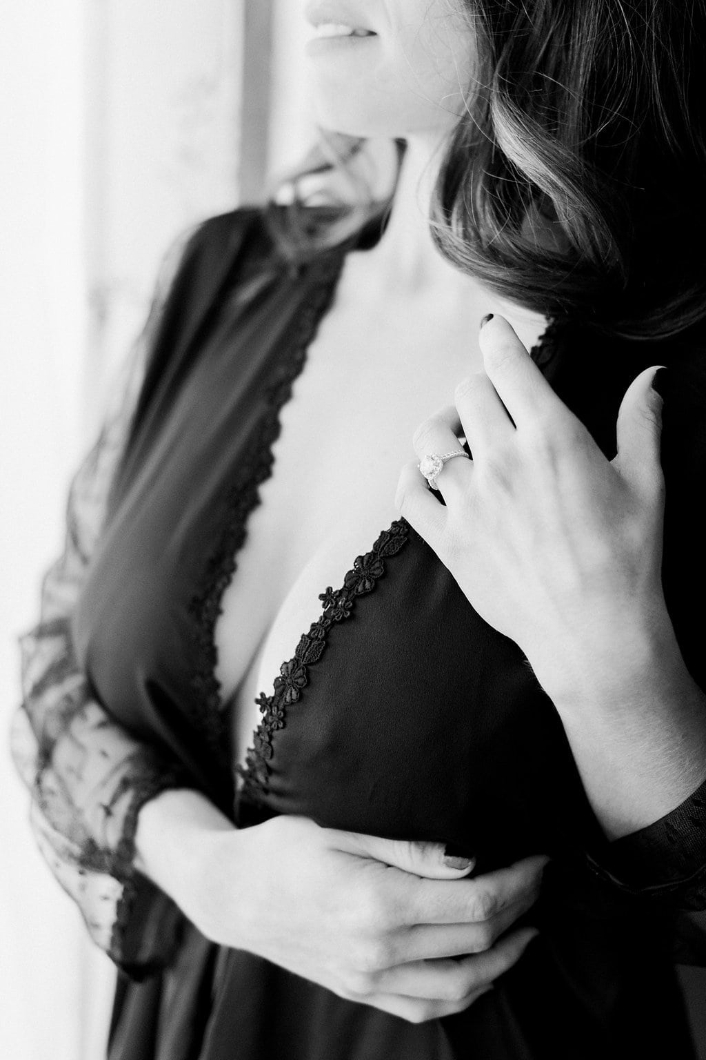 Black and white image of boudoir photo using window light