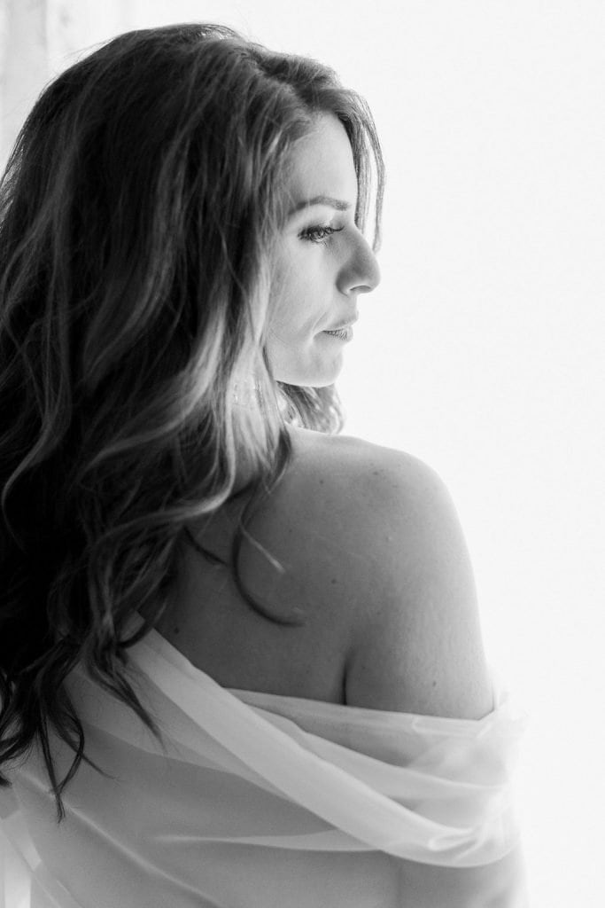 Side view of bride during boudoir session using window light in black and white: Pittsburgh Boudoir Photography