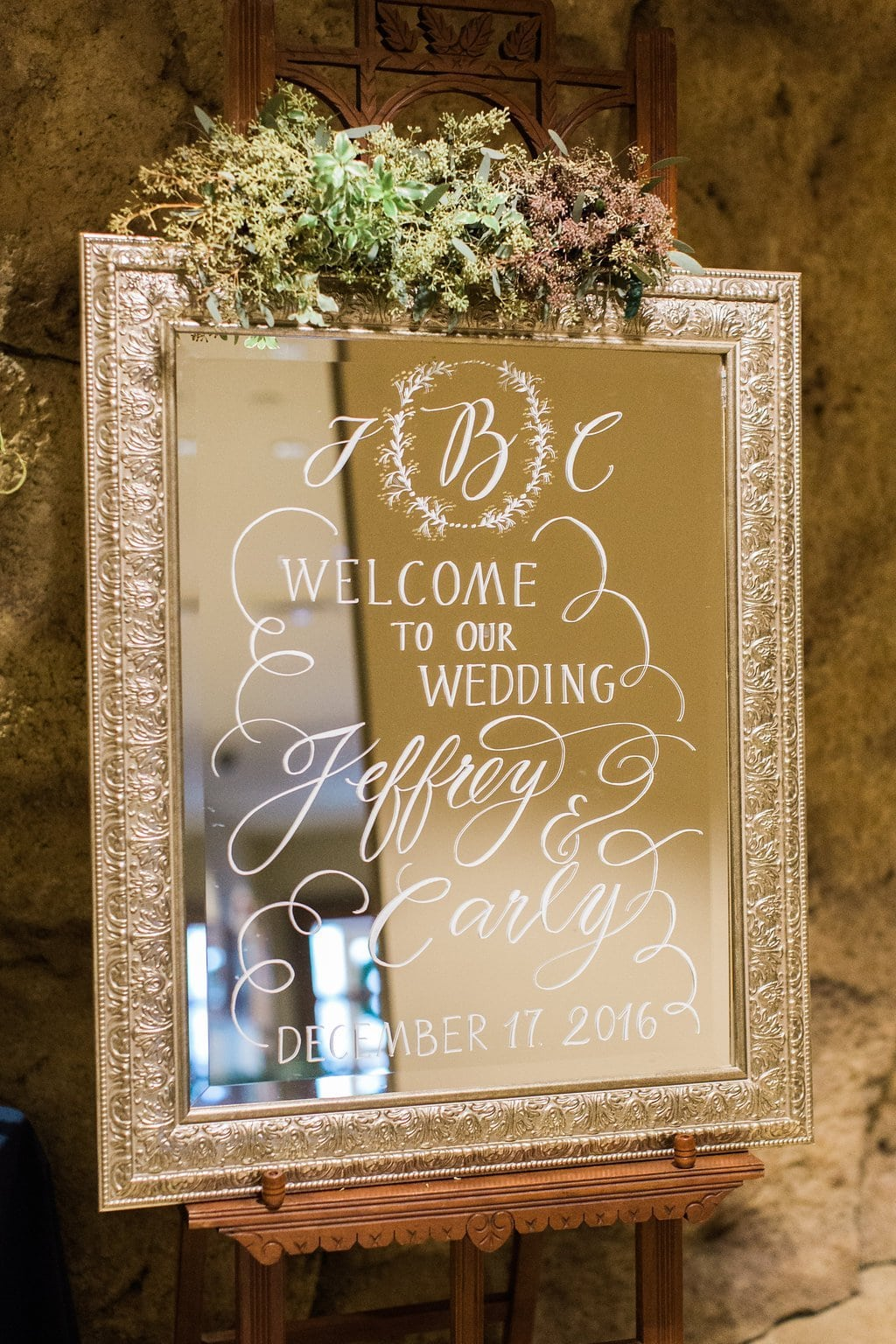 Ceremony details of mirror with white calligraphy - J Verno Studios Winter Wedding