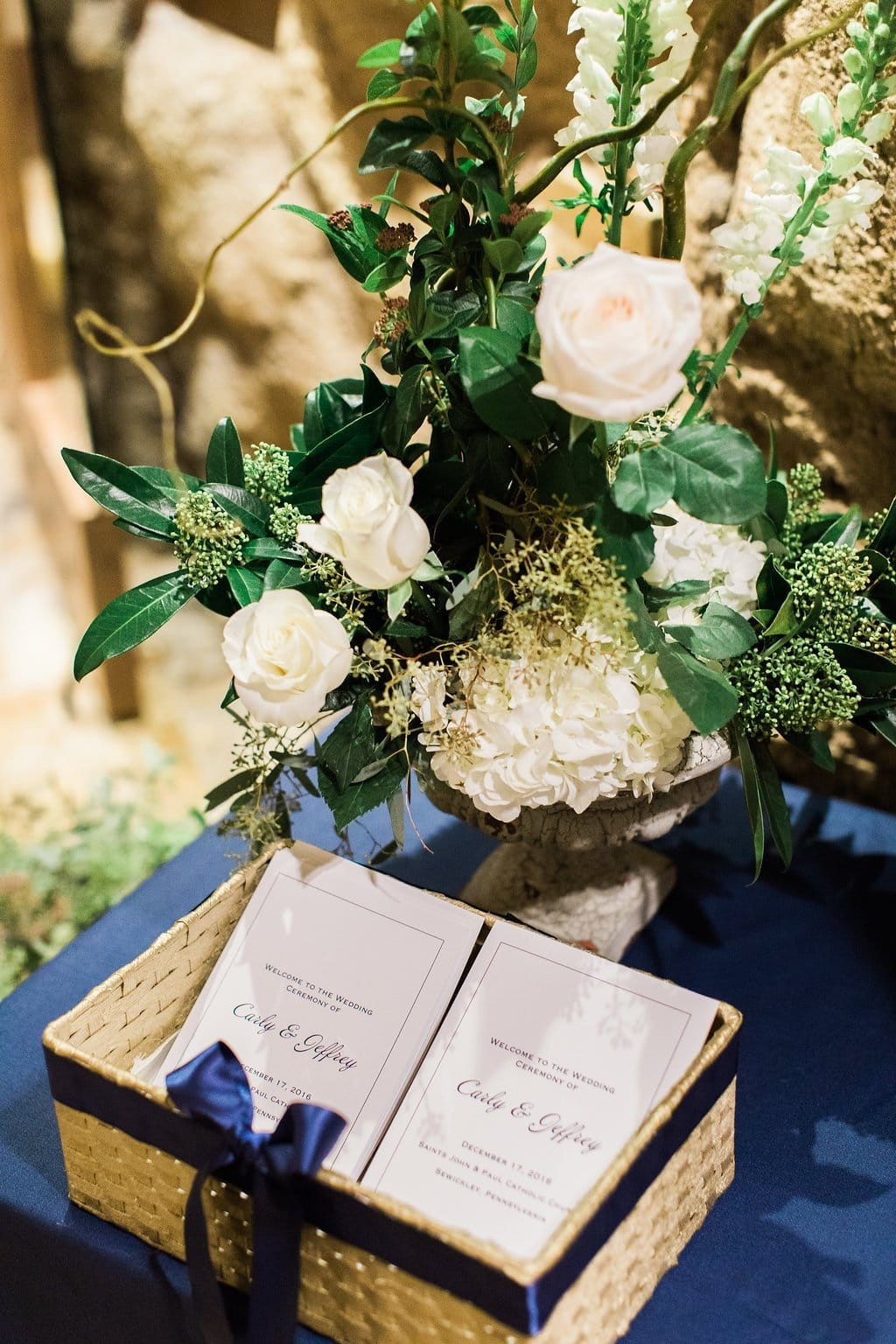 Ceremony details of flowers and programs - J Verno Studios Winter Wedding