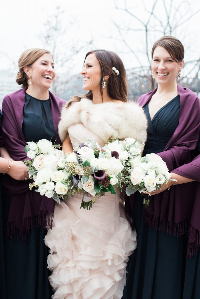 Bride with her bridesmaids on a snowy and cold winter day in the Southside of Pittsburgh