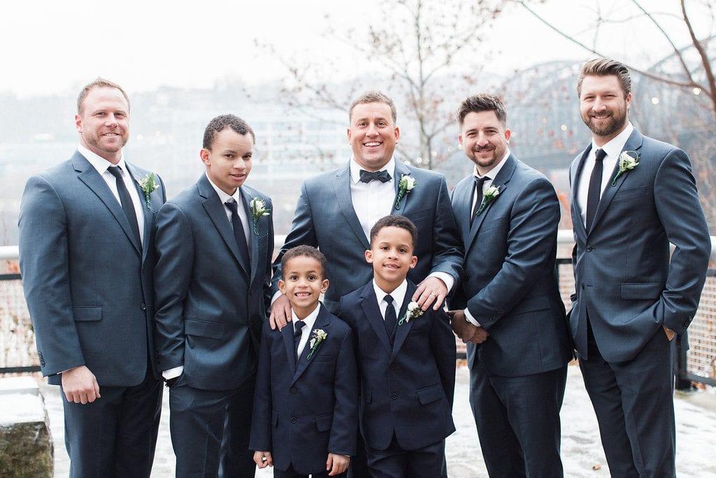 Groom with his groomsmen winter wedding photography