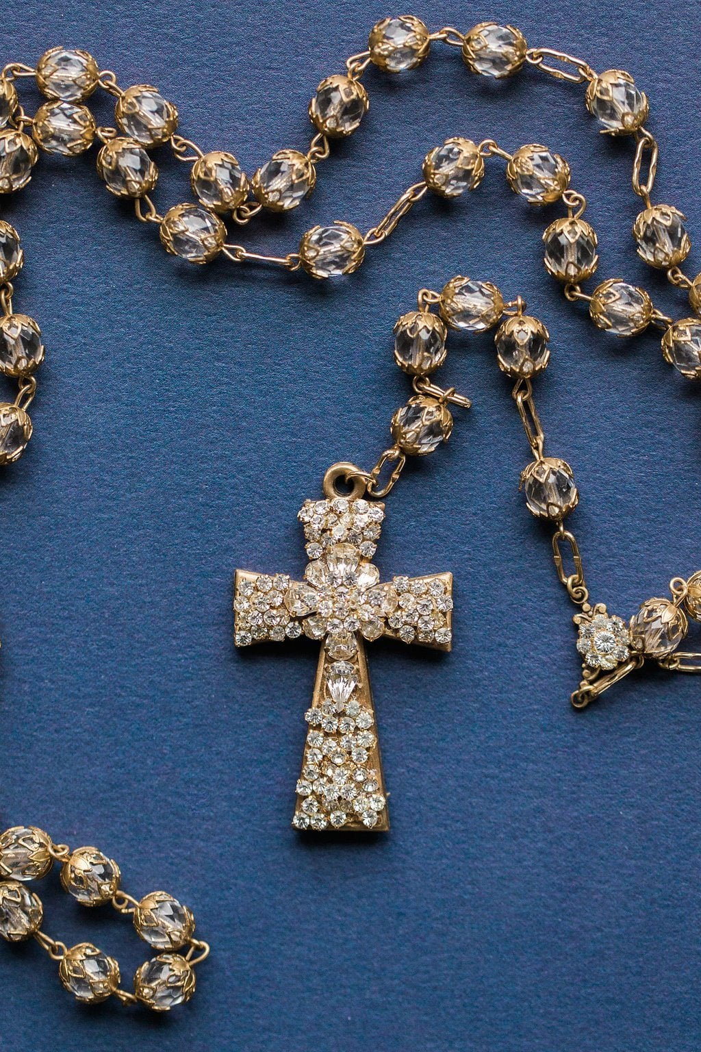 Photograph of gold and diamond rosary cross