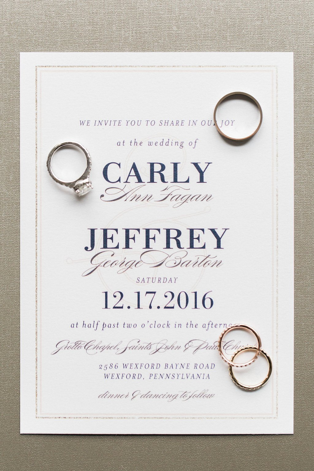 Photo of the wedding invitation and rings