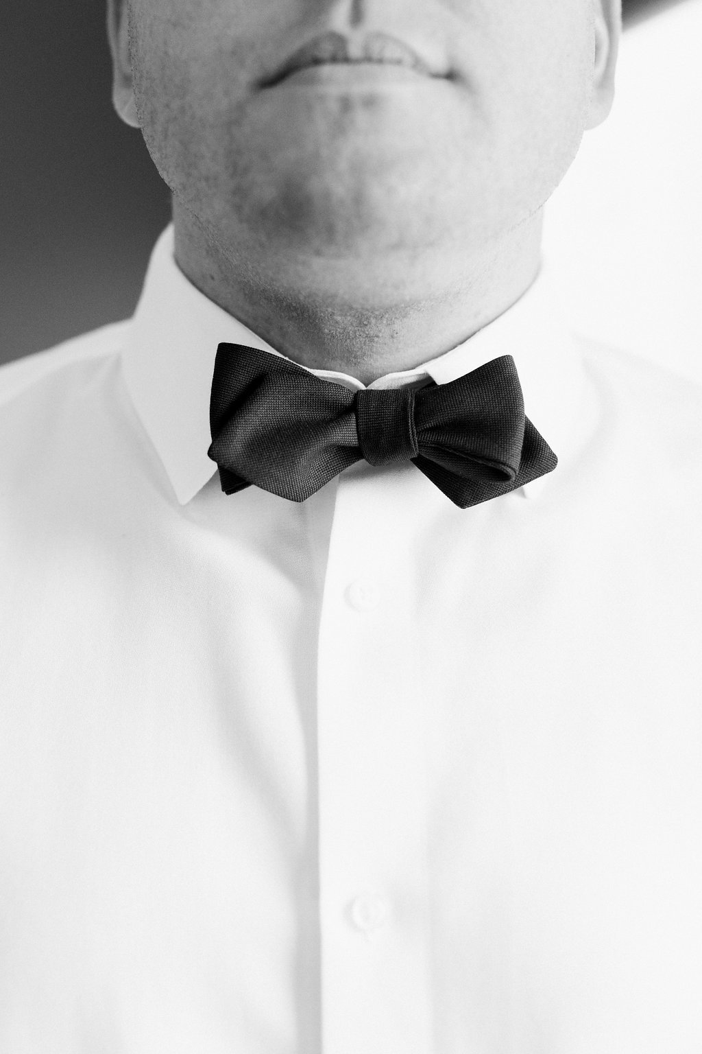 Close up photo of groom's bowtie during getting ready portraits
