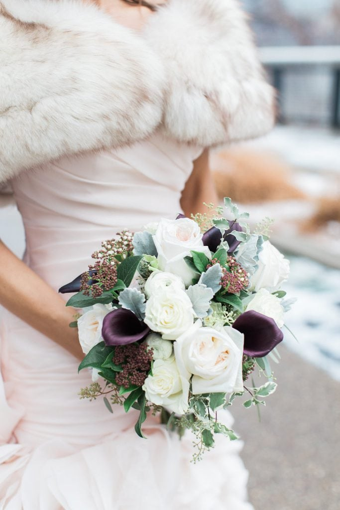 Photo of the bride's purple and blush pink bouquet
