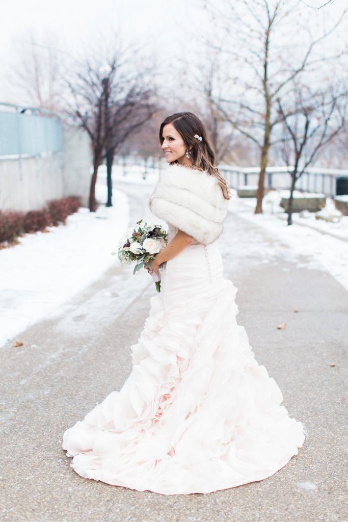 Bride wearing blush pink wedding gown in the snow during winter wedding in Pittsburgh