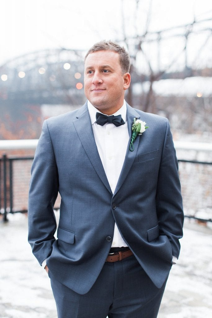 Portrait of the groom outside in the snow during winter wedding at J. Verno Studios