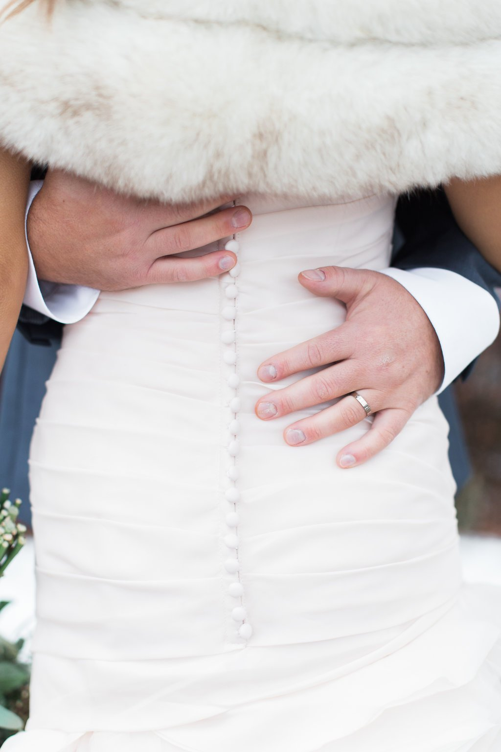 Portrait of groom grabbing bride's waist showing wedding ring - J Verno Studios Winter Wedding