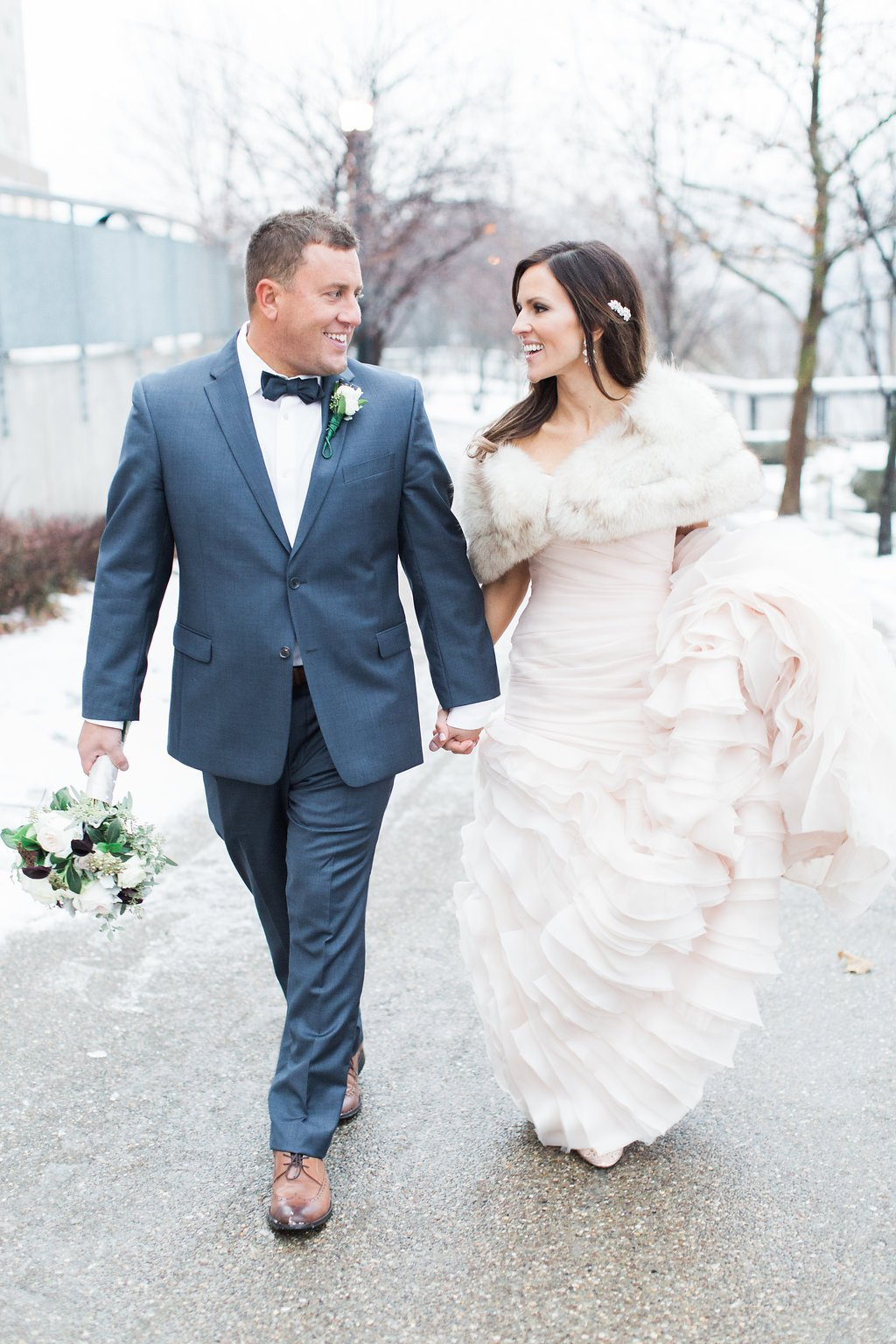 Bride and Groom photographs at December wedding bride wearing a blush pink wedding gown- J Verno Studios Winter Wedding