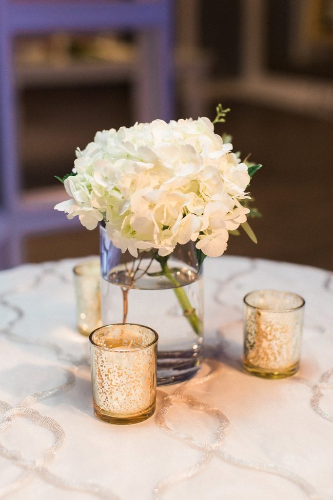Cocktail details flowers and votive candles during reception at J. Verno Studios