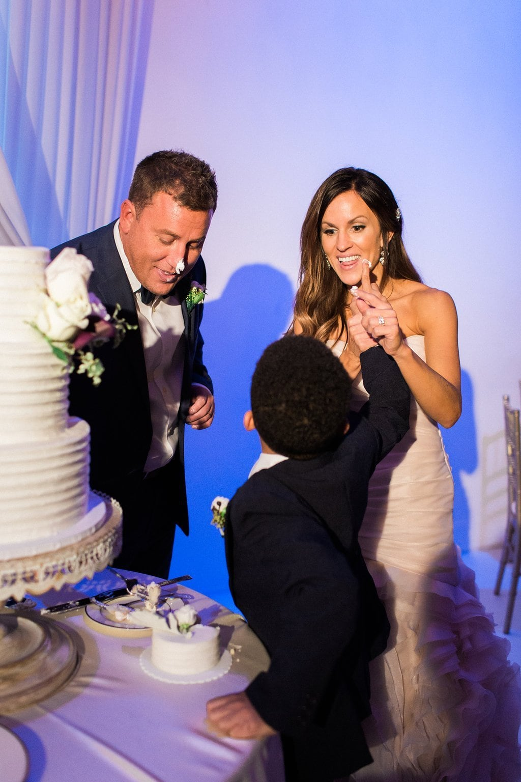 Cake cutting during reception at J. Verno Studios in Pittburgh - J Verno Studios Winter Wedding