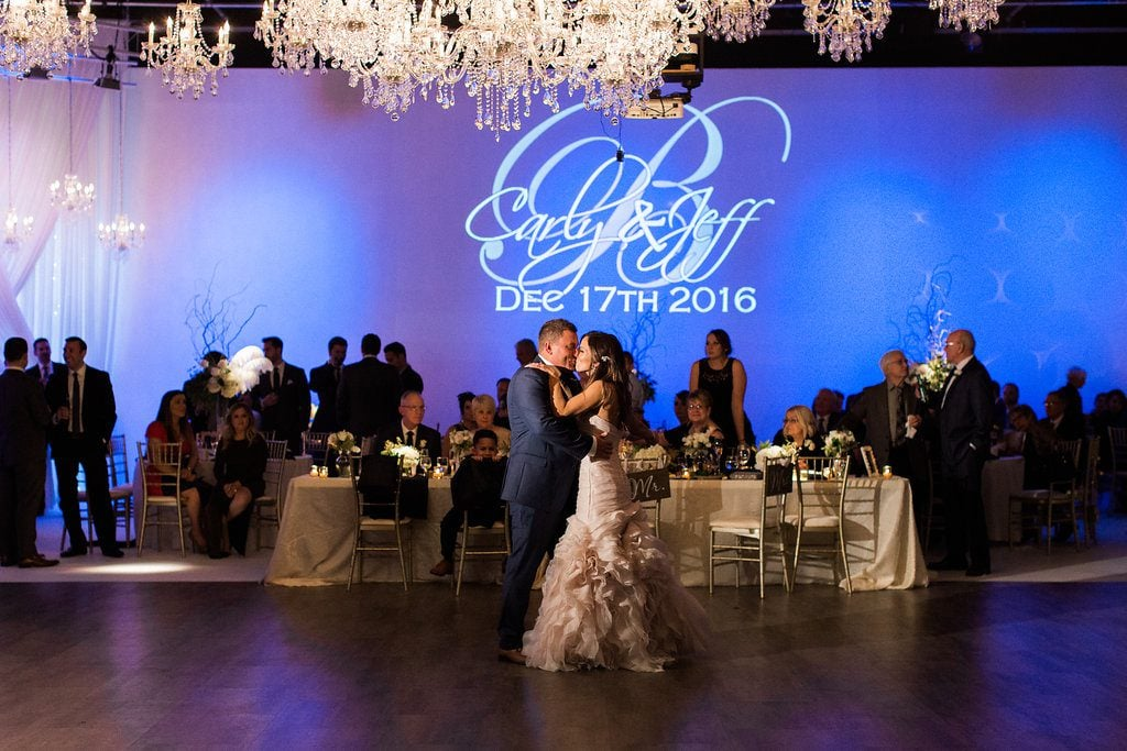 Bride and groom sharing their first dance at their wedding reception at J. Verno Studios