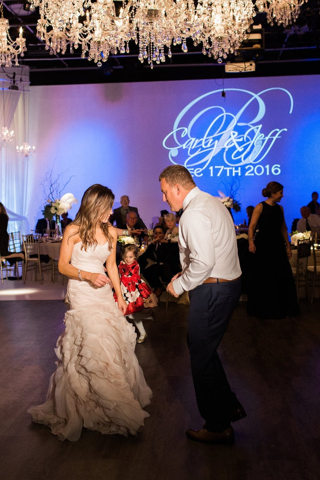 Bride and Groom sharing a dance at J. Verno Studios - J Verno Studios Winter Wedding