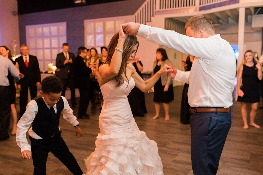 Bride and groom dancing at their wedding reception at J. Verno Studios