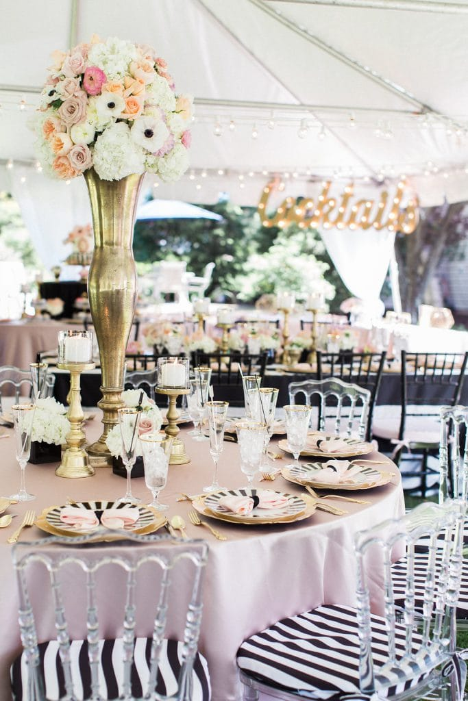 black and white with pink and gold accent bridal shower under white tent in backyard
