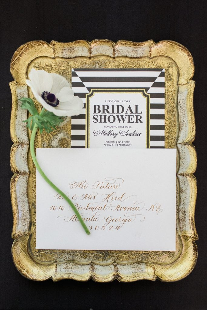 black and white bridal shower invitations on gold antique tray