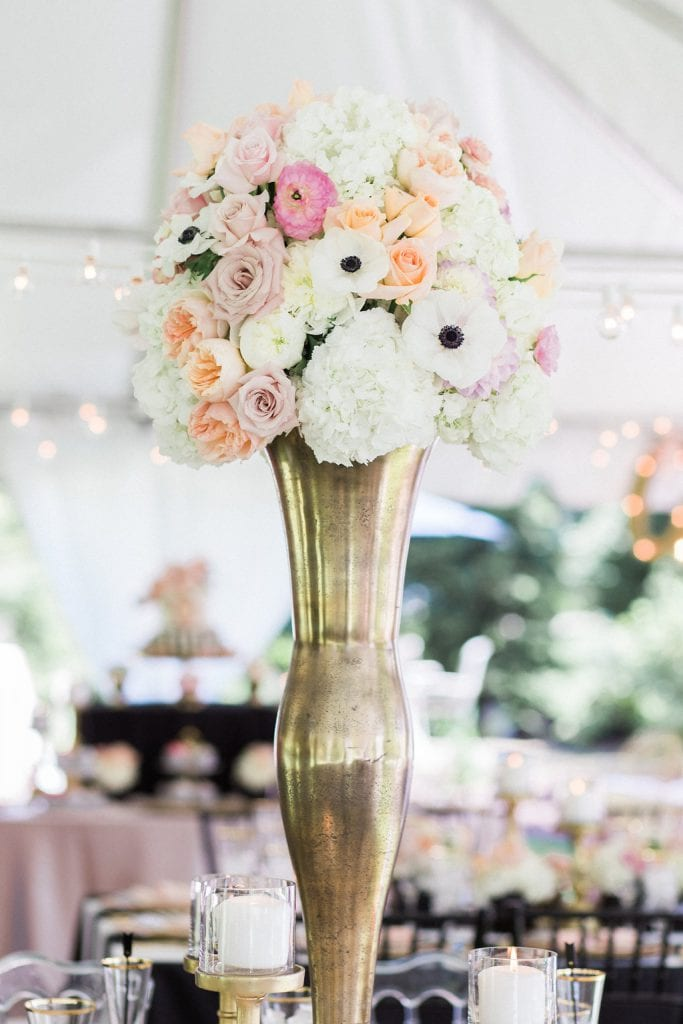 pink and white tall floral arrangements in gold vases