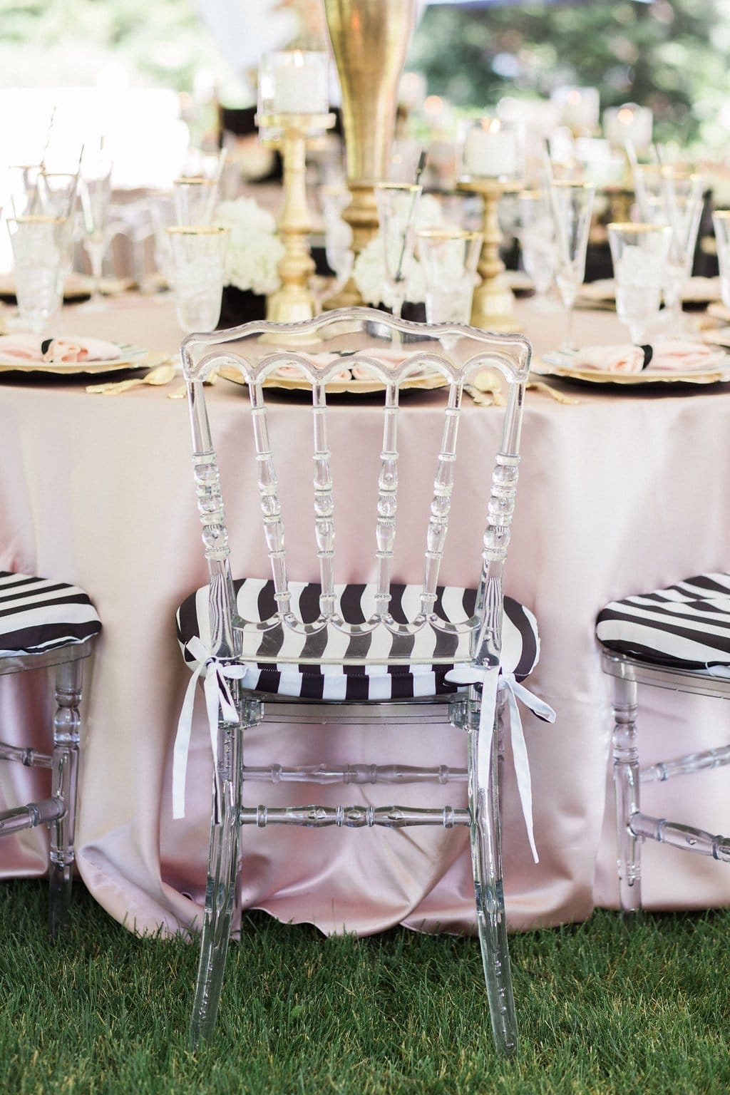 acrylic chairs with black and white cushions and pink table cloth - Black & White Kate Spade Inspired Bridal Shower