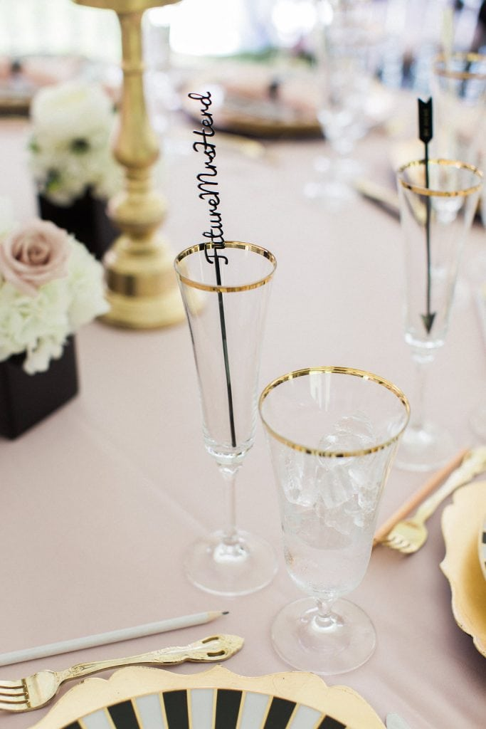 gold rimmed kate spade glasses at bridal shower