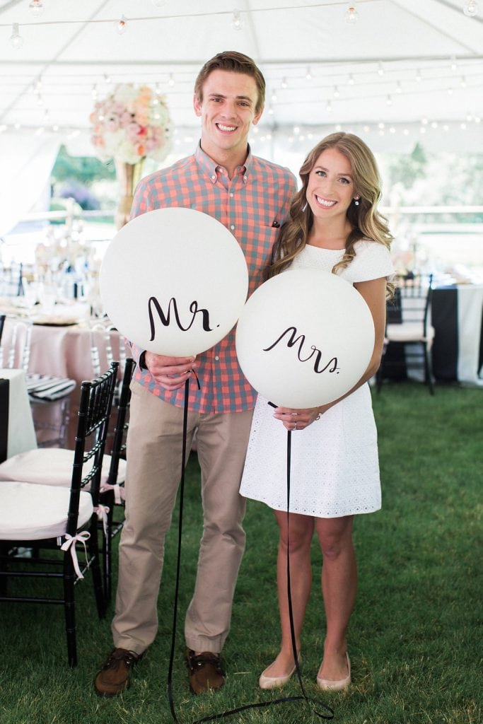 bride and groom with white mr. and mrs. balloons at bridal shower