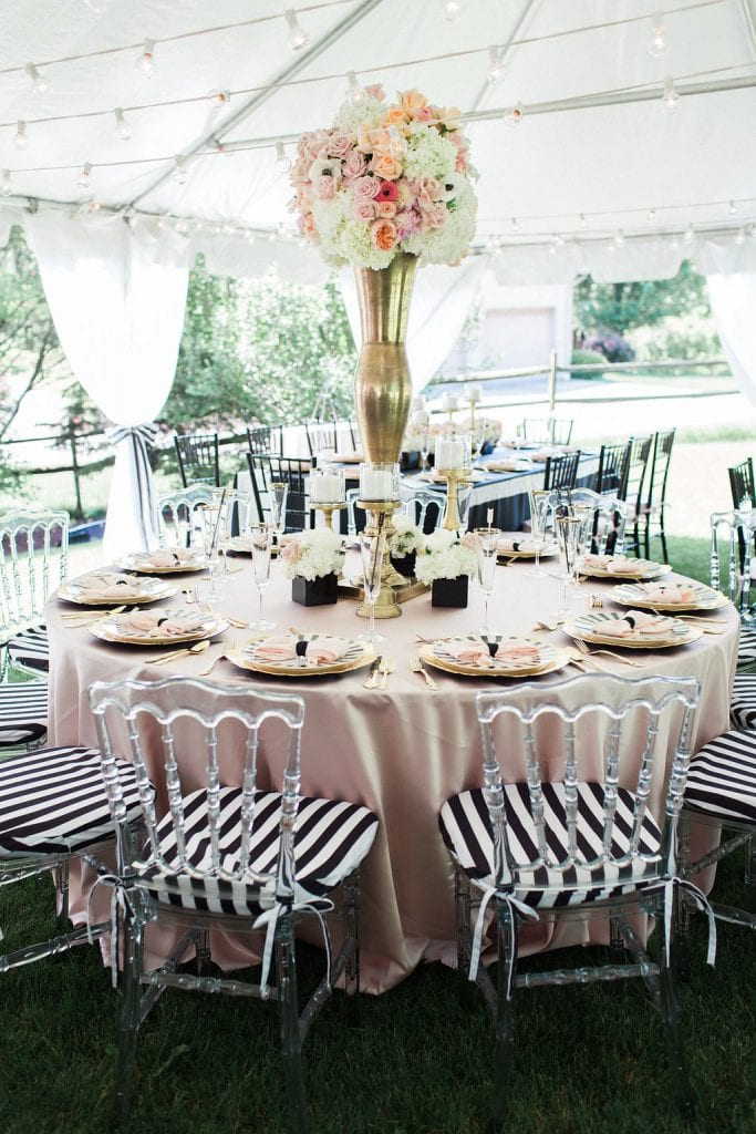 bridal shower with pink table cloth, black and white accents and florals