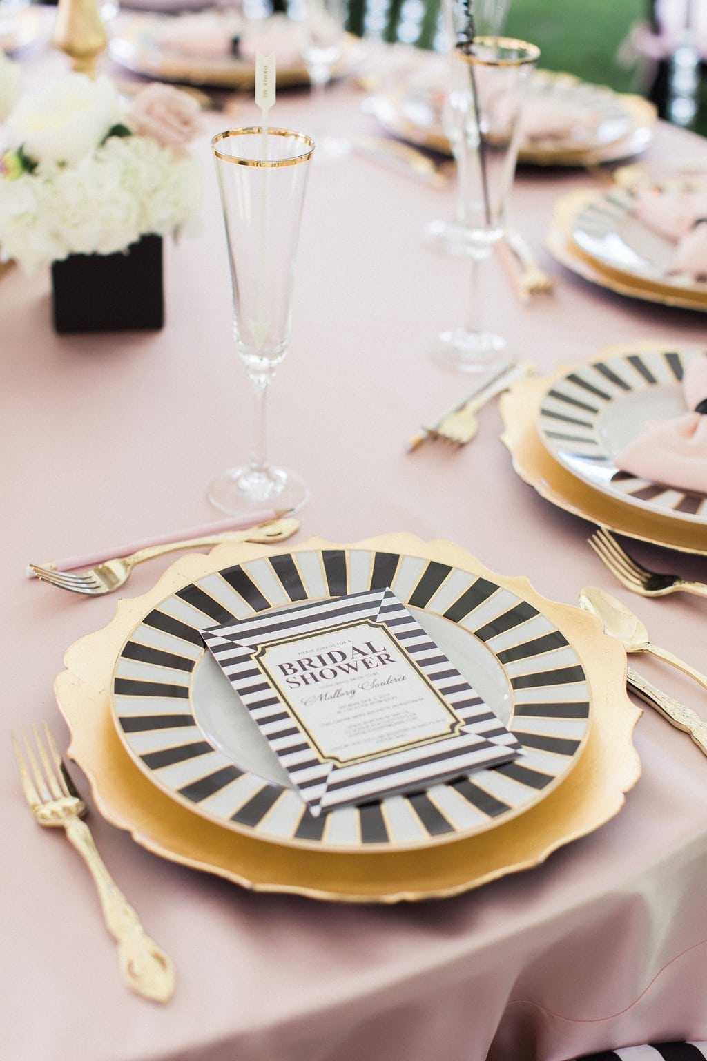 black and white plate with gold charger and pink table cloth - Black & White Kate Spade Inspired Bridal Shower