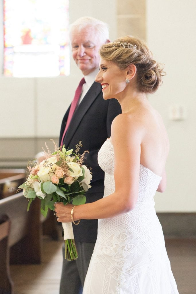 Bride being walked down the aisle by Arthur Thomas, man who has her father's donated heart