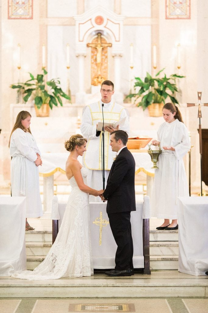 Bride and groom exchange rings at their wedding ceremony